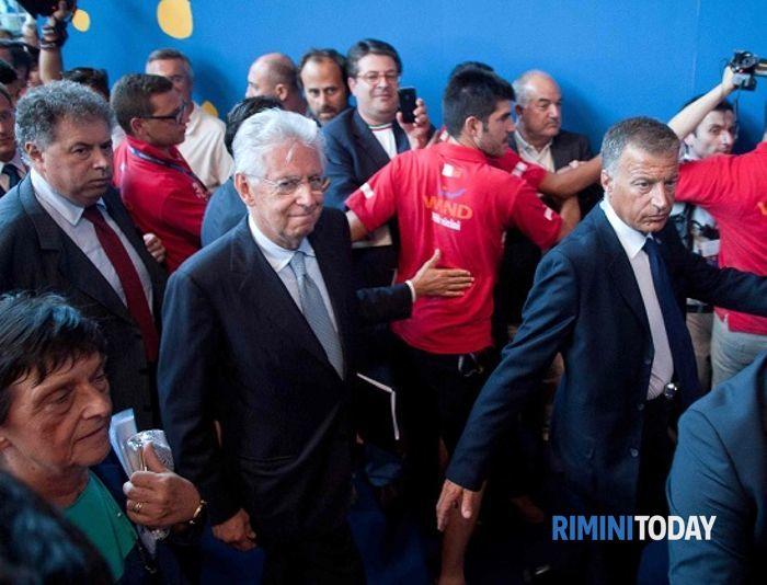 L'arrivo di Mario Monti al Meeting di Rimini (Infophoto)